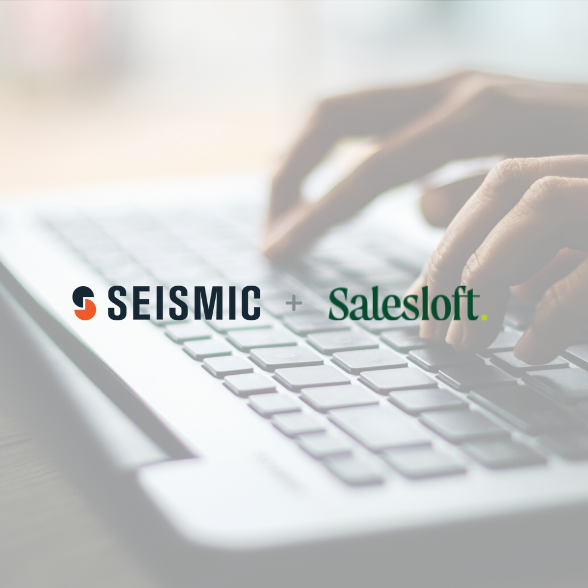 Seismic and Salesloft logos over a background image of hands on a keyboard